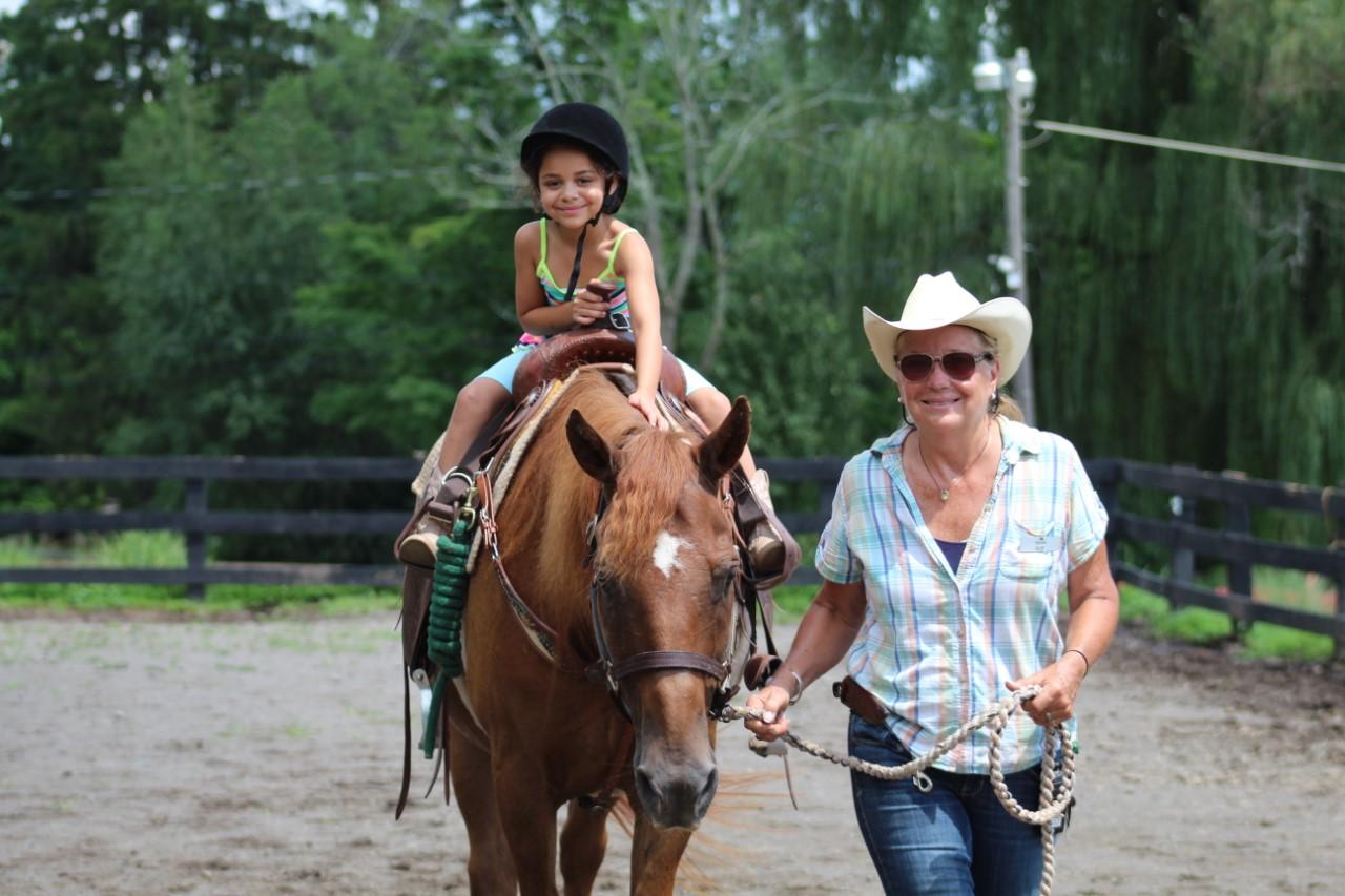 Pine Ridge Dude Ranch Girl on Horse
